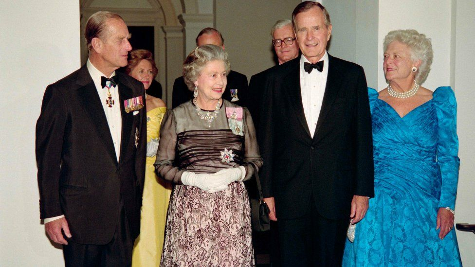 George HW Bush and First Lady Barbara Bush arrive at a dinner at the British Embassy with Queen Elizabeth II and her husband, Prince Philip in Washington, DC