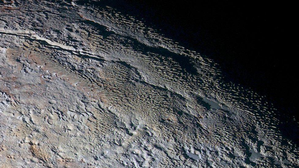 Pluto - snakeskin terrain
