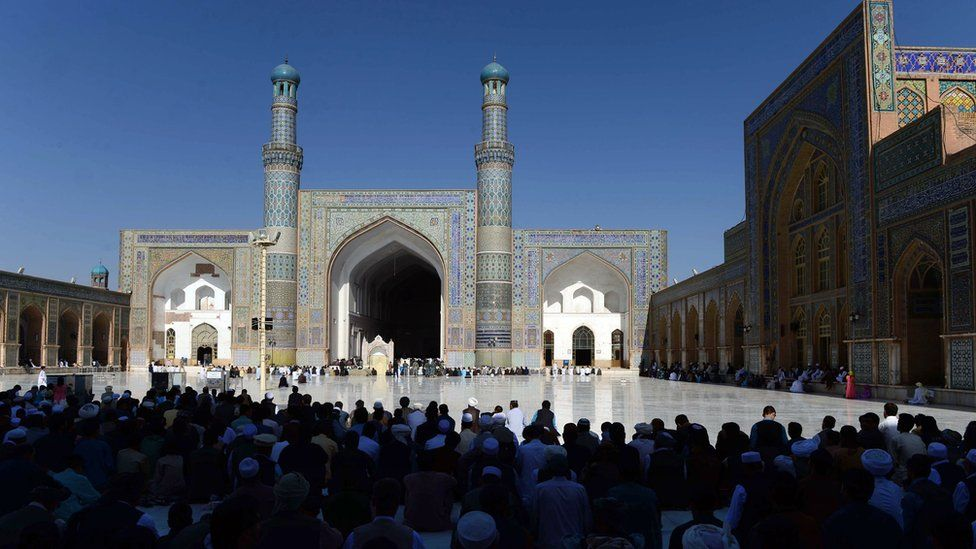 Afghan devotees offer prayers at the start of the Eid al-Fitr holiday which marks the end of Ramadan at the Jamee (mosque) in Herat on July 17, 2015