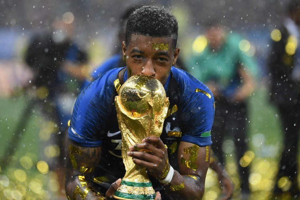 France's defender Presnel Kimpembe kisses the World Cup trophy after winning the Russia 2018 World Cup final football match between France and Croatia at the Luzhniki Stadium in Moscow on July 15, 2018.