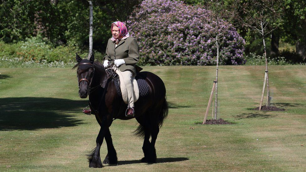 The Queen has been photographed riding in the grounds of Windsor Castle - the first time she has been seen outside since the coronavirus lockdown began.