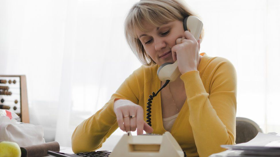 woman on landline phone