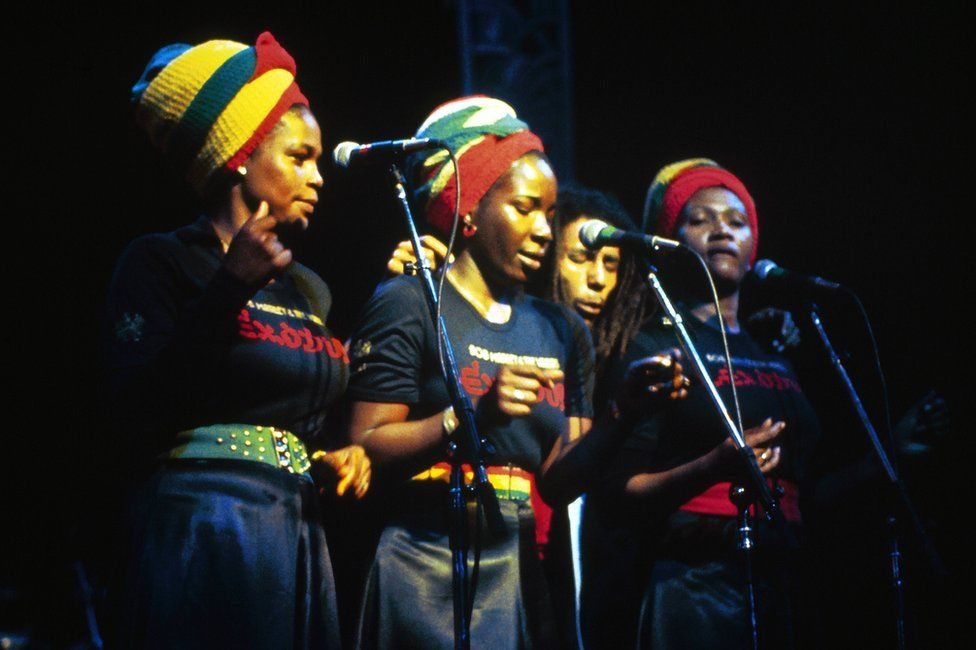 Bob Marley and the I-Threes perform together at the Rainbow Theatre in London in 1977