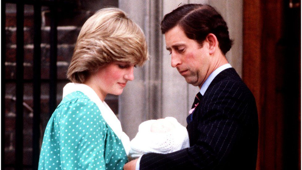 Prince and Princess of Wales holding baby Prince William