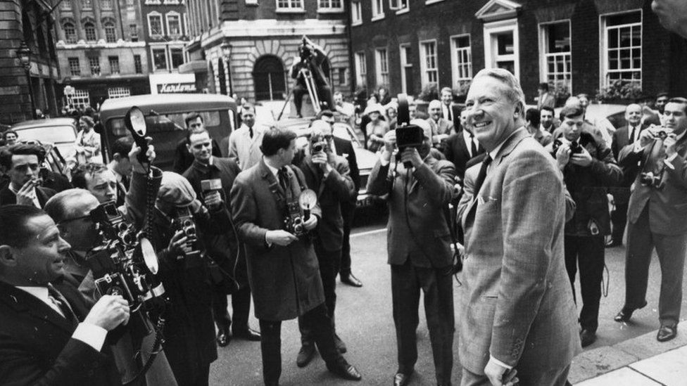 Ted Heath faces cameramen on leaving his home in Albany House, Piccadilly, London, 1965
