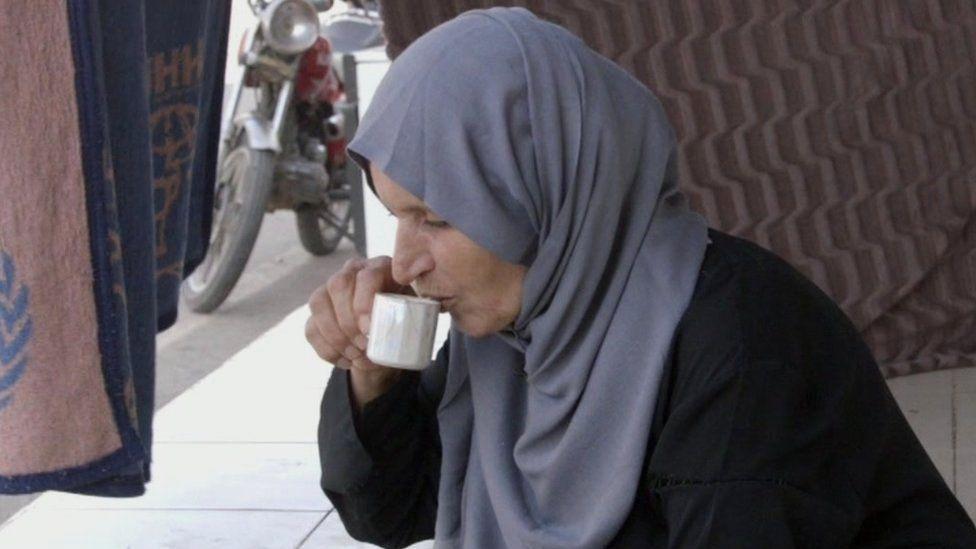 Kawther Jahwani drinking coffee
