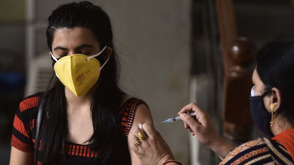 A woman being vaccinated in Gurugram, India