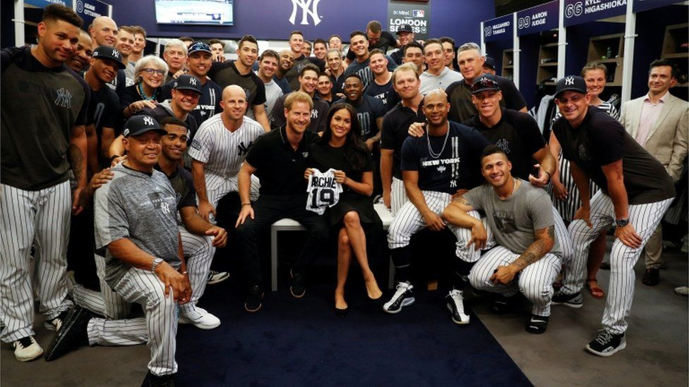 The royal couple pose with the New York Yankees ahead of the game