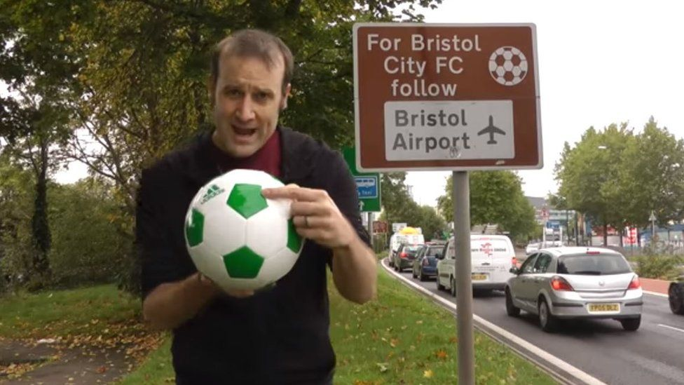 Matt Parker holding a football
