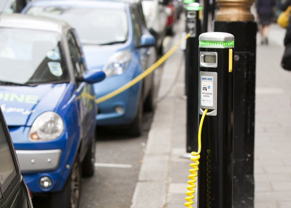 electric cars at charging stations