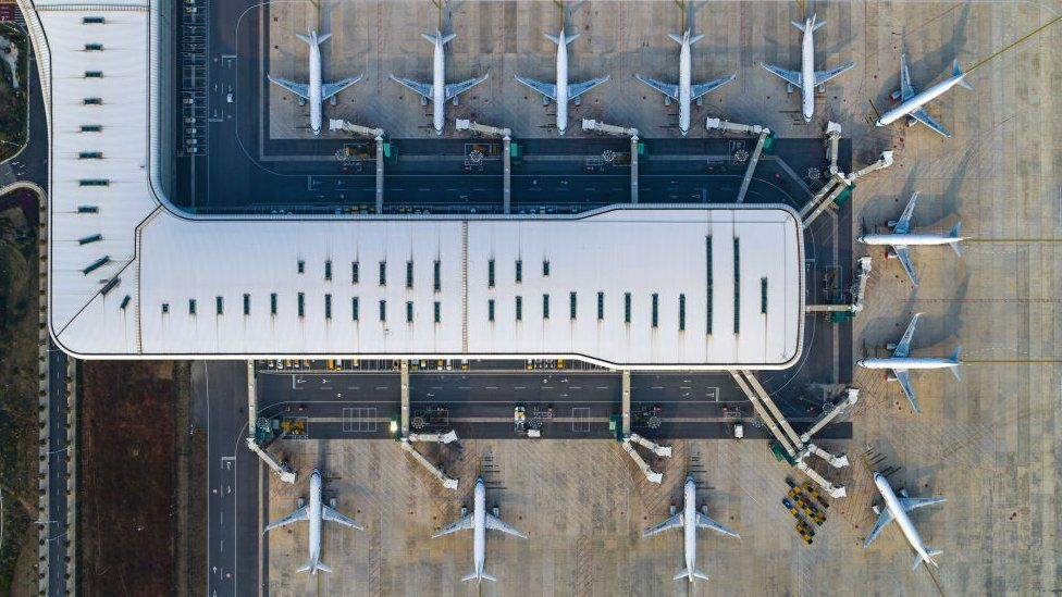 aerial view of the passenger planes and terminal building of Wuhan Tianhe International Airport in China
