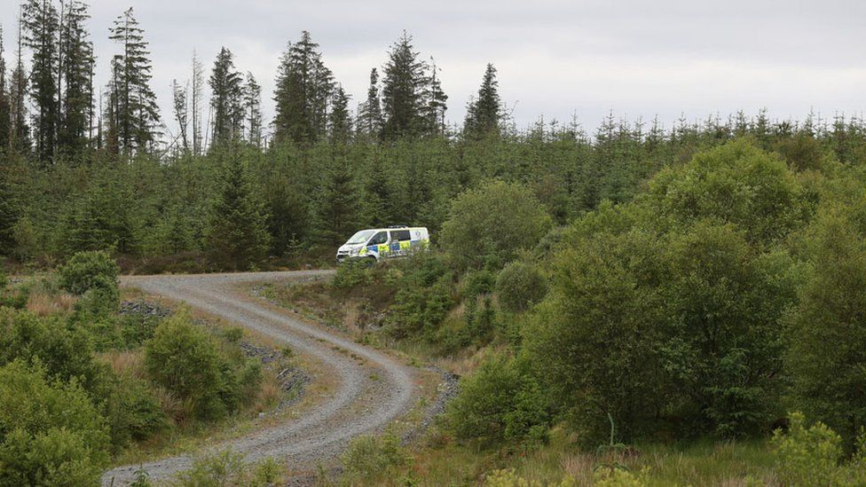 Police at the scene where the body was found