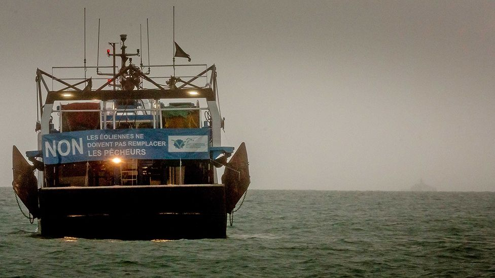 A French fishing boat with a protest sign opposing new fishing licenses on May 6, 2021 in St Helier, Jersey.