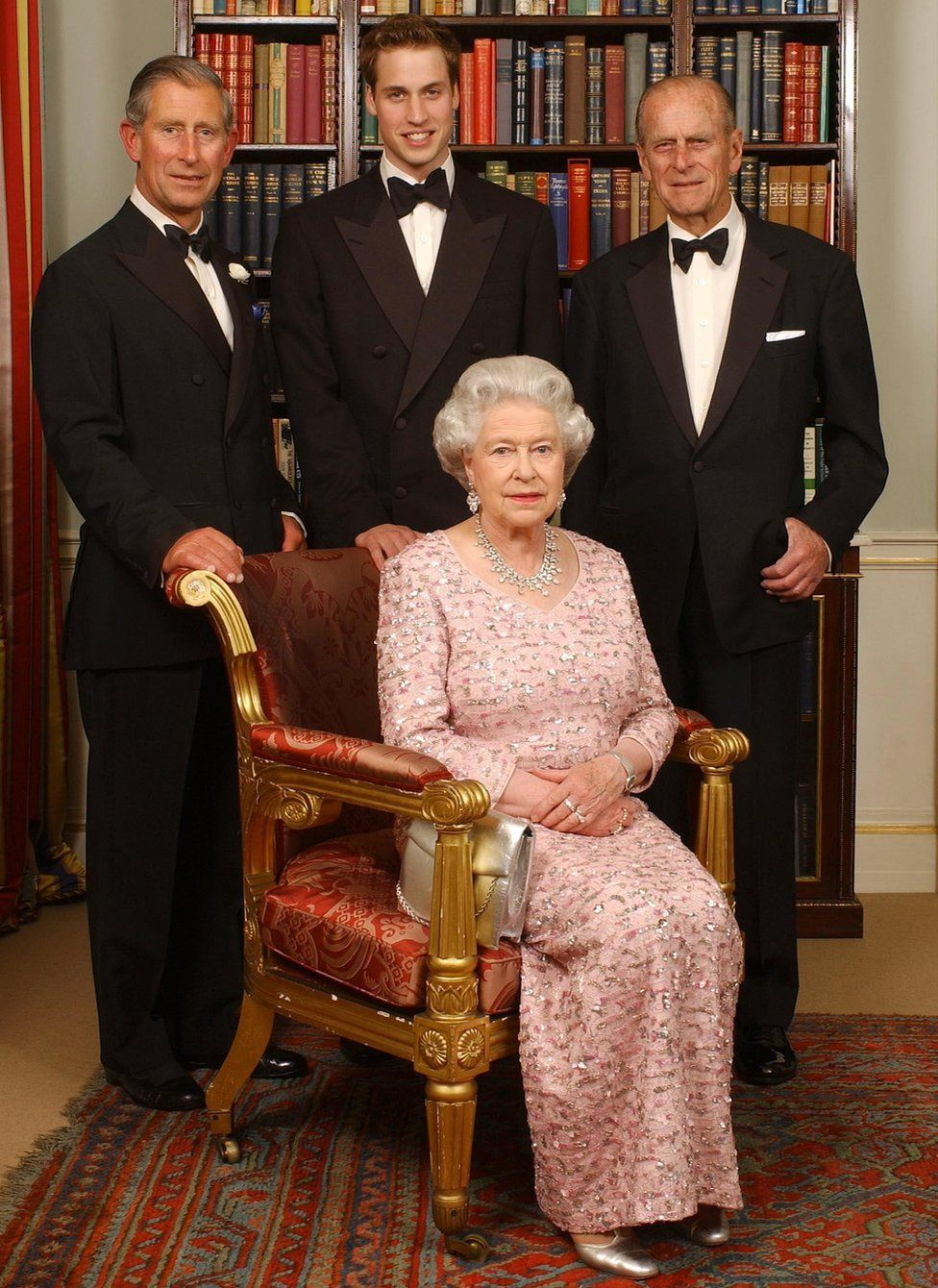 Three generations of the British Royal family - Queen Elizabeth II and her husband, the Duke of Edinburgh, their oldest son, the Prince of Wales, and his oldest son, Prince William, at Clarence House in London