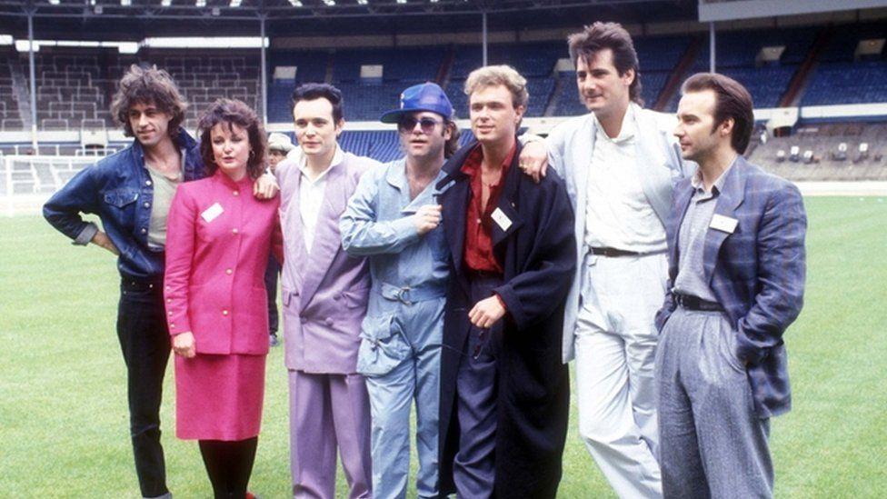 Bob Geldof, Janice Long, Adam Ant, Elton John, Gary Kemp, Tony Hadley and Midge Ure pictured as part of Band Aid, 1984