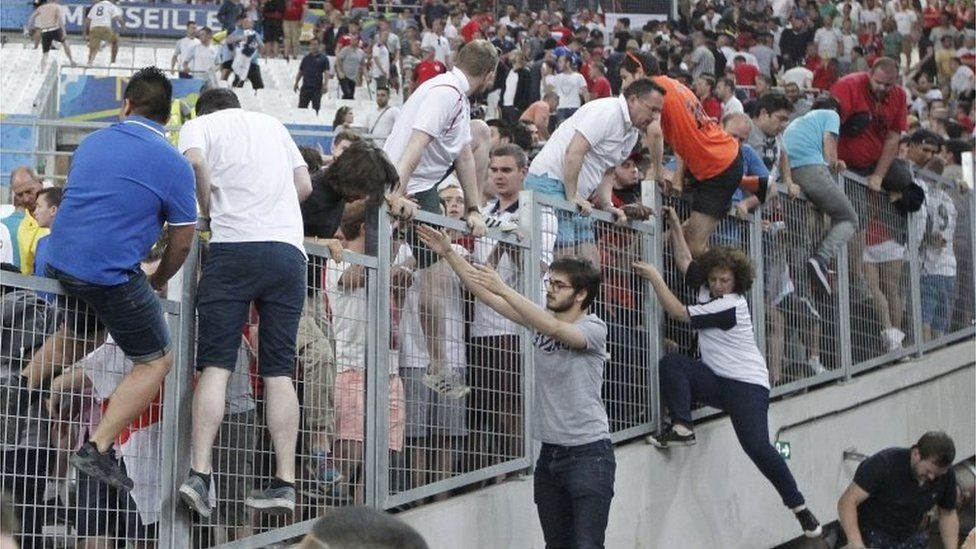 Fans escape a charge by Russian supporters