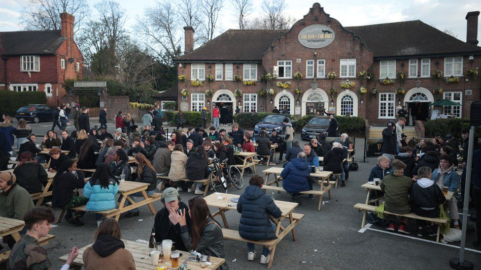 Drinkers at the Fox on the Hill pub in London