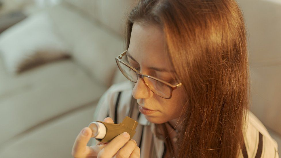 young woman with brown inhaler