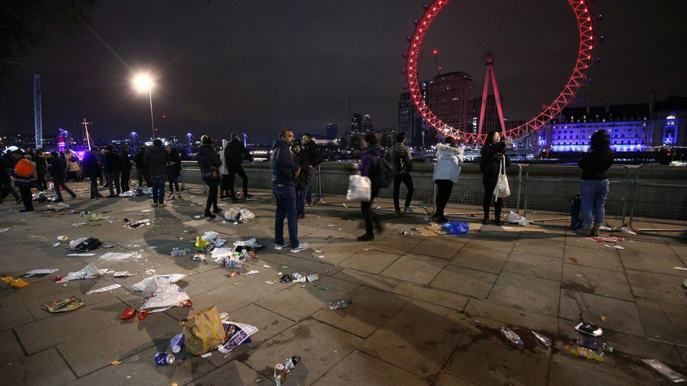 Revellers head home from central London following the fireworks display