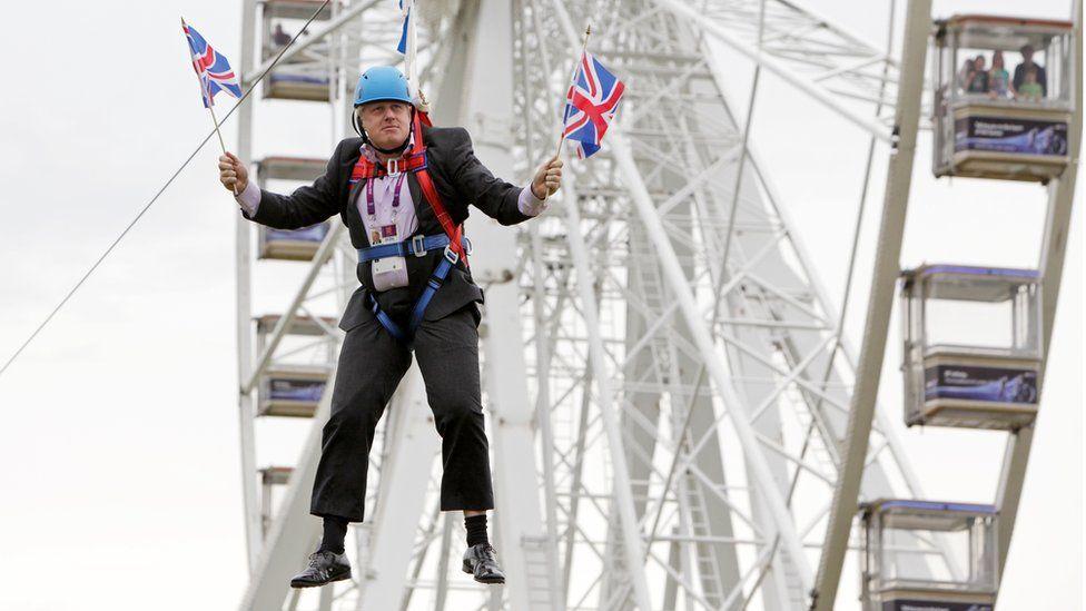Boris Johnson stuck on a zip wire in July 2012 (file photo)