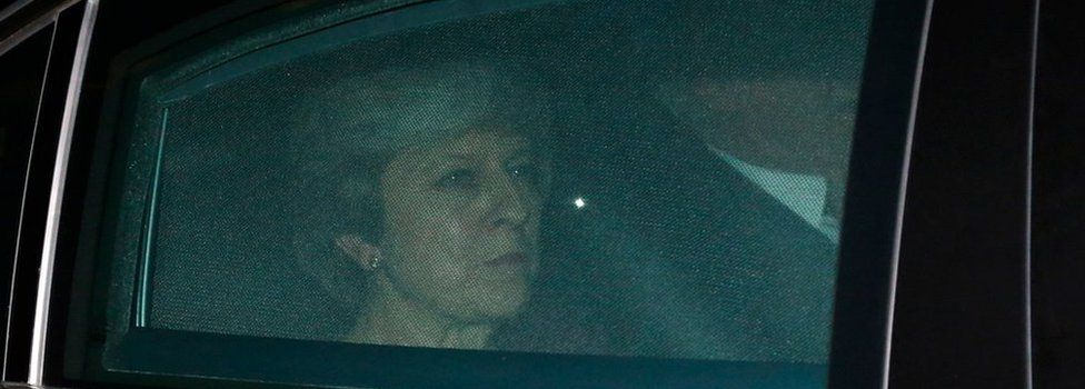 Theresa May leaves the European Commission headquarters in Brussels