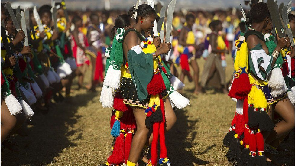 Tens of thousands of maidens, dressed in traditional garb, perform the reed dance for the king during the Umhlanga festival