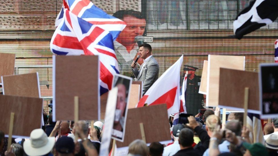 Tommy Robinson greets his followers outside the Old Bailey in July 2019