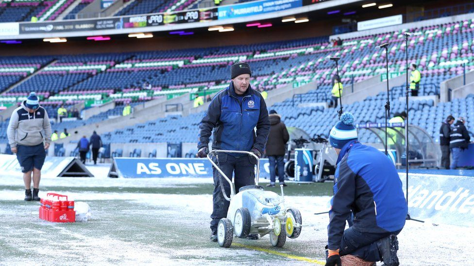 Ground staff clear snow at Murrayfield on 2 February 2019