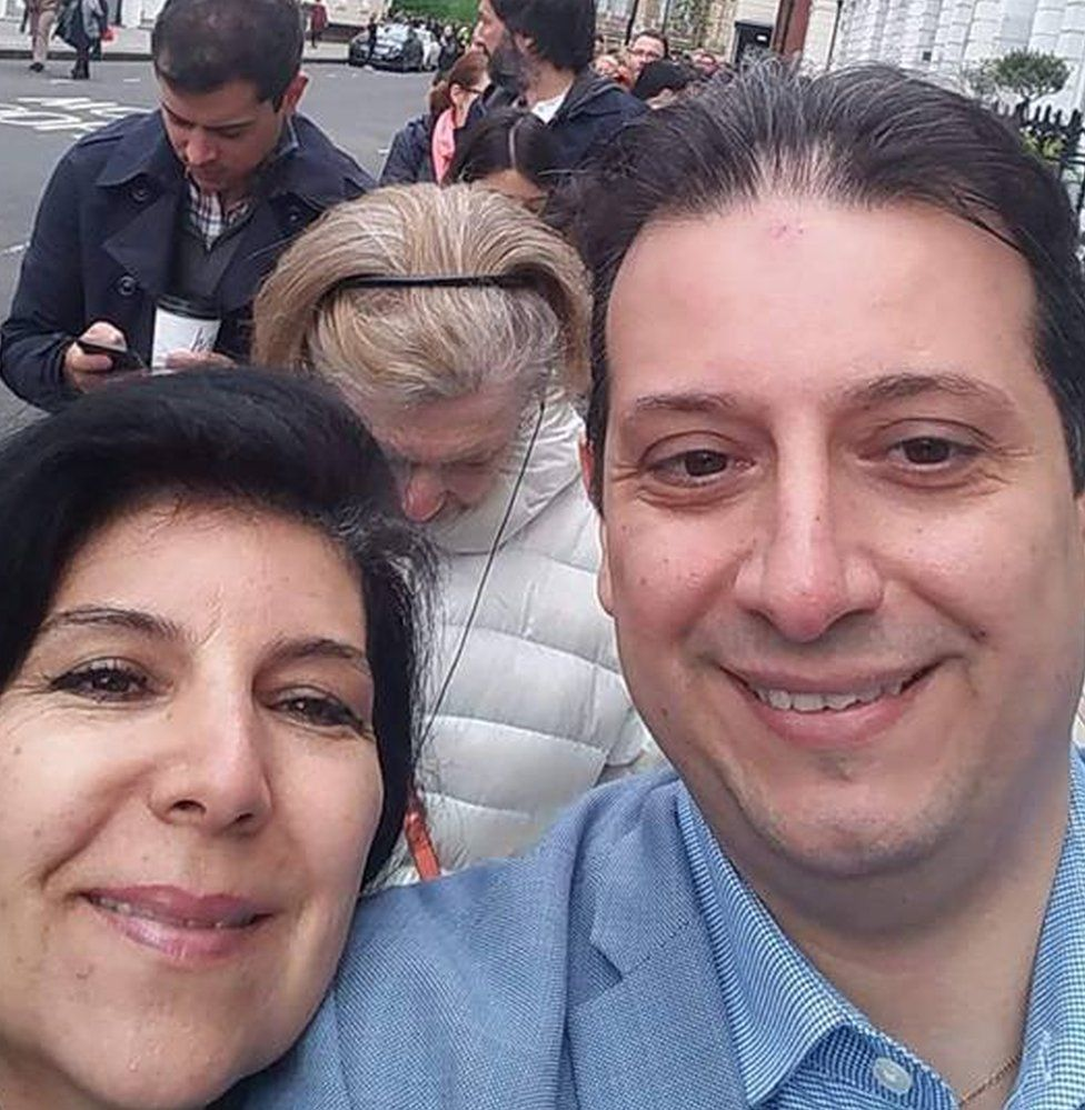 Nadia Darcy and her brother Othmane in the queue waiting to vote
