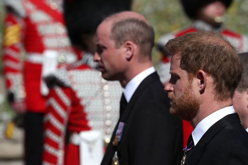 Prince William, Duke of Cambridge, (L) and Britain's Prince Harry, Duke of Sussex follow the coffin during the ceremonial funeral procession of Prince Philip, Duke of Edinburgh to St George's Chapel in Windsor Castle in Windsor, on April 17, 2021.