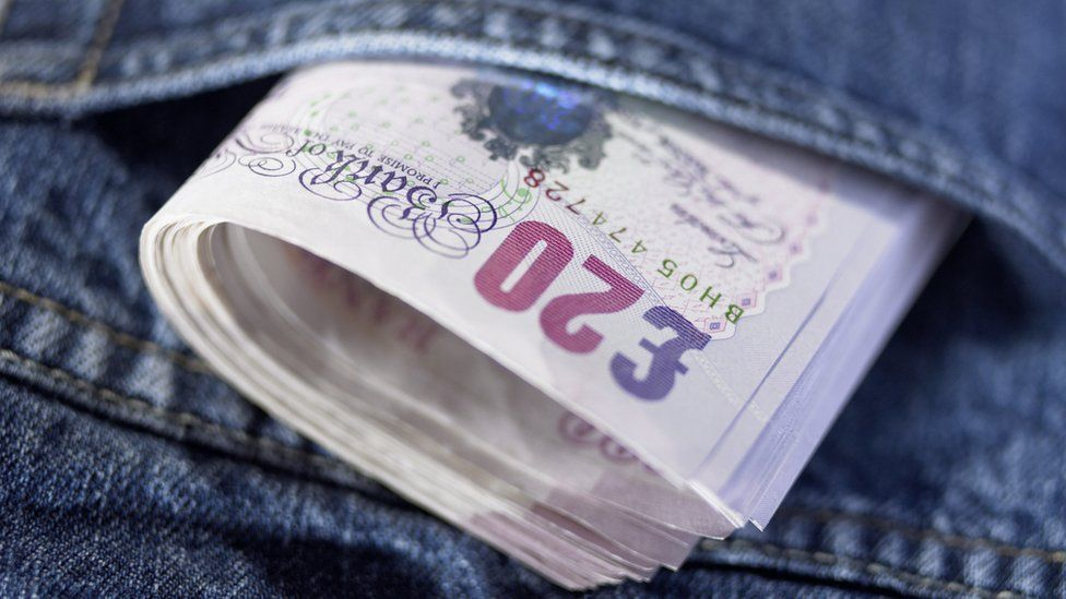 Twenty pound notes in a pocket