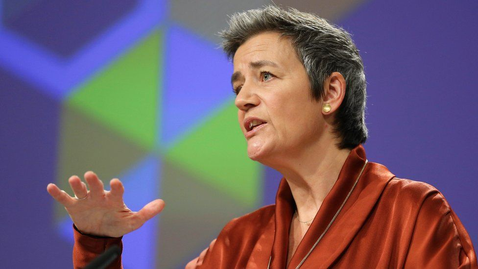 Margrethe Vestager gestures as she speaks from a podium