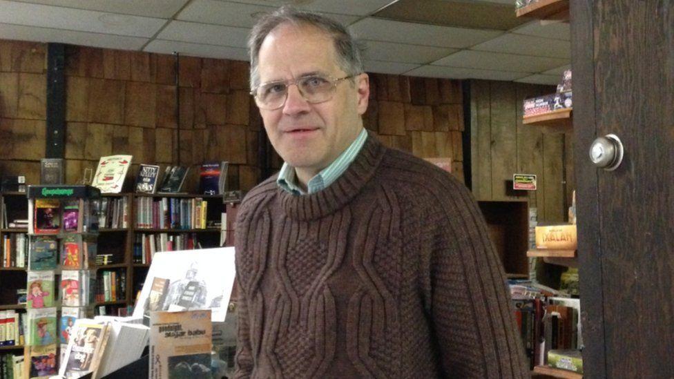 David Koehl, standing in his bookstore