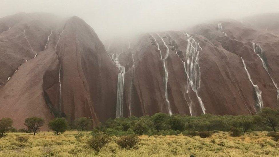 Waterfalls from Uluru after heavy rain