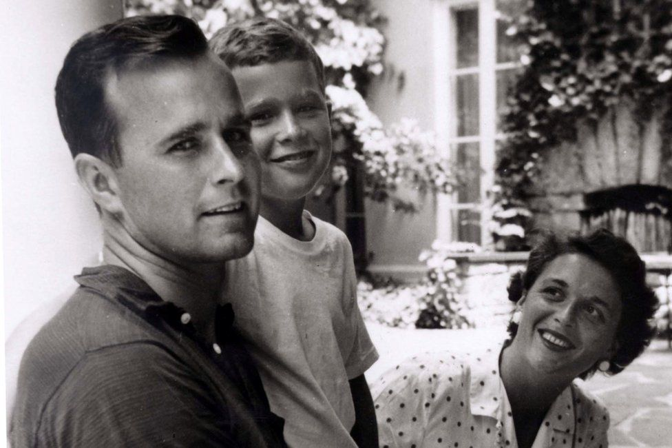 George W. Bush is shown with his father, future President George Bush and mother, future first lady Barbara Bush in Rye, New York, in this file photo taken during the summer of 1955.