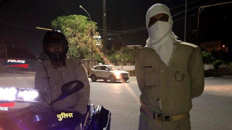 Policemen patrol street stay vigilant in the night as well