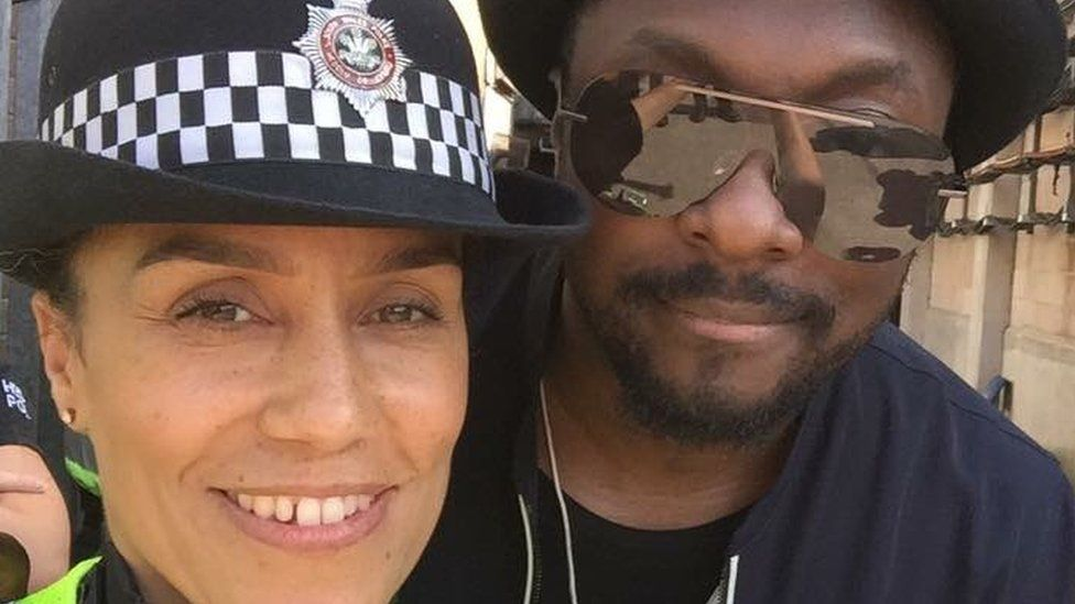PC Debbie Johnson getting into the spirit with Black Eye Peas' will.i.am