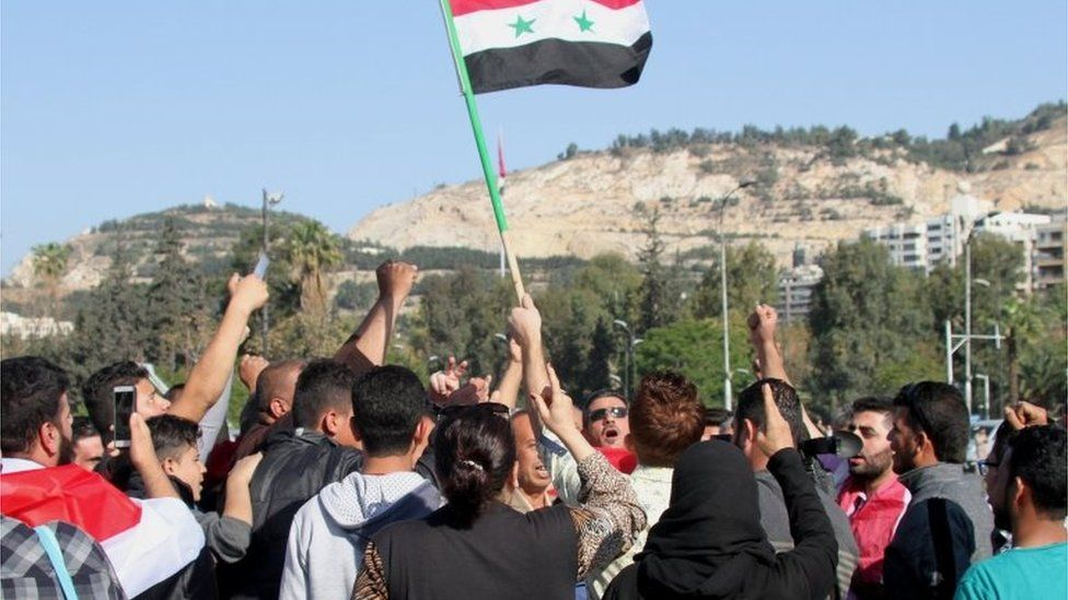 Syrians show support for President Assad after US-led air strikes in response to a suspected chemical weapons attack blamed on the government, 14 April 2018