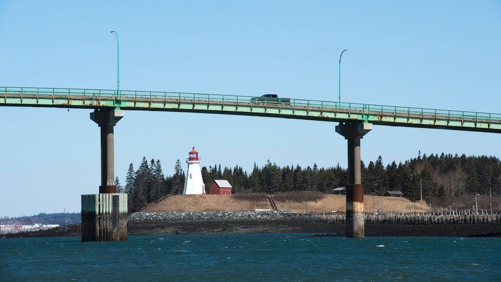 Cars cross the International Bridge between Lubec, Maine (L) and Campobello Island, Canada