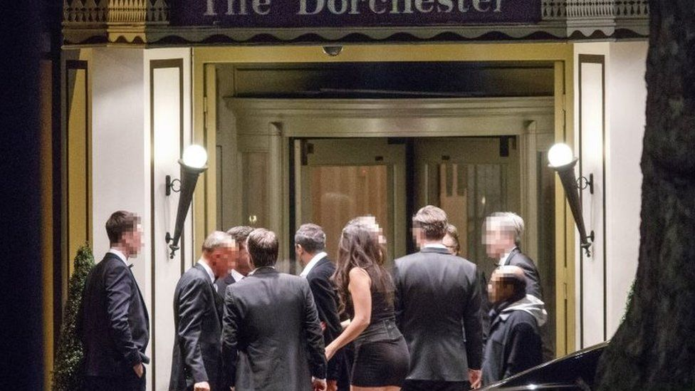 Guests of the dinner outside the Dorchester
