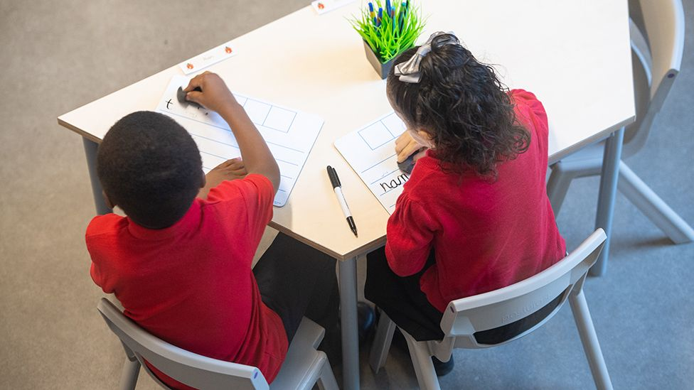 Two children at school table
