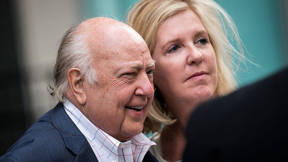 Fox News chairman Roger Ailes walks with his wife Elizabeth Tilson as they leave the News Corp building, July 19, 2016 in New York