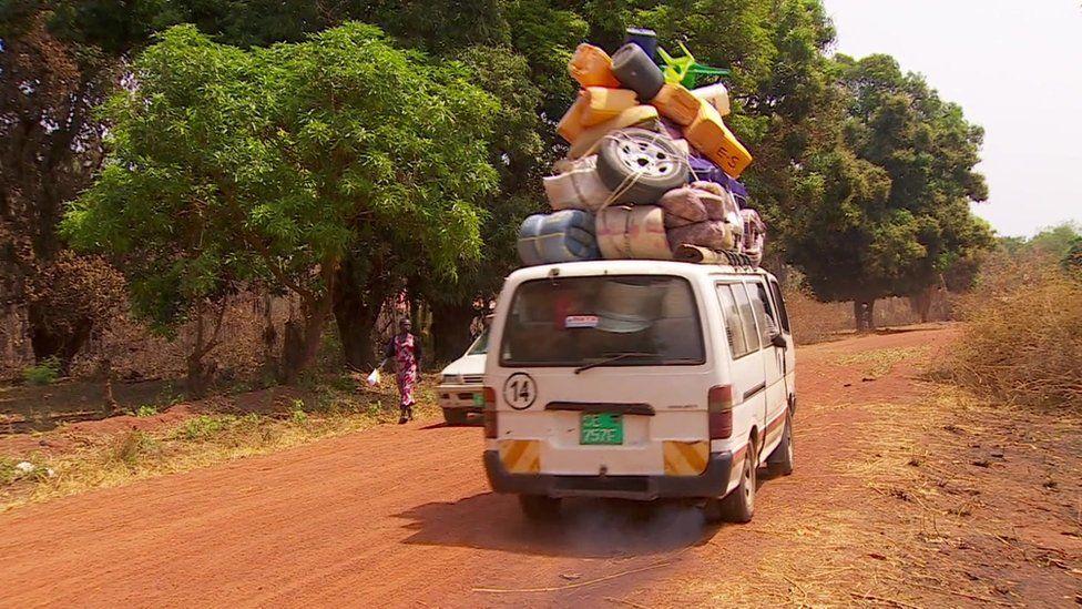 A van leaving Yei in South Sudan