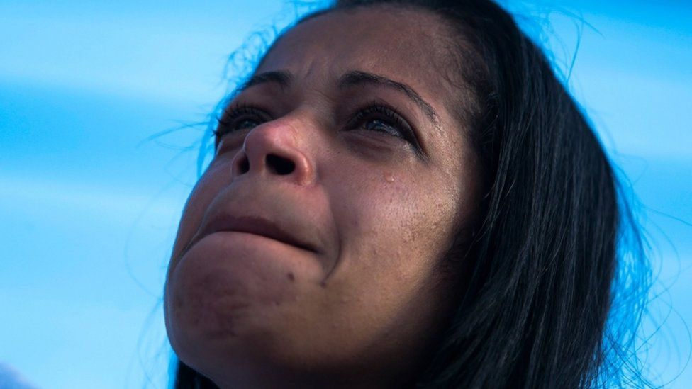 Brazilian Joyce da Silva dos Santos, mother of teenager Guilherme Silva Guedes, who disappeared in Vila Clara, cry during a protest and mass against his death in Sao Paulo, Brazil, on 21 June 2020