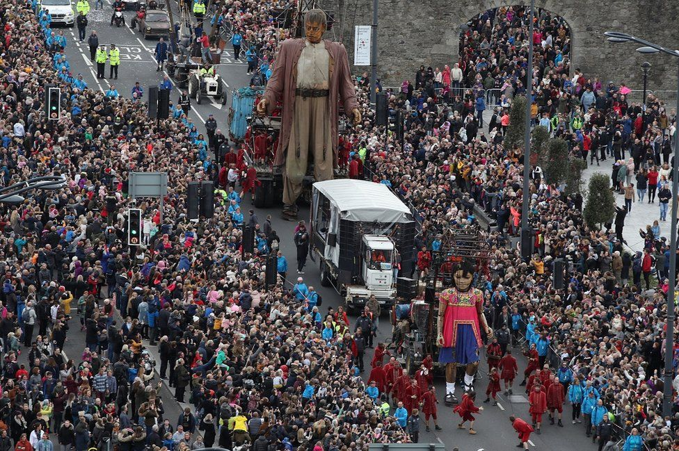 """""""Giants"""" street puppets during a street theatre performances"""