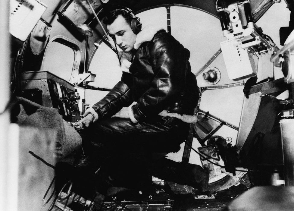 Bombardier, Lieutenant Harry Erickson of the 97th Bomb Group, in the nose of a B-17 Flying Fortress, July 1942