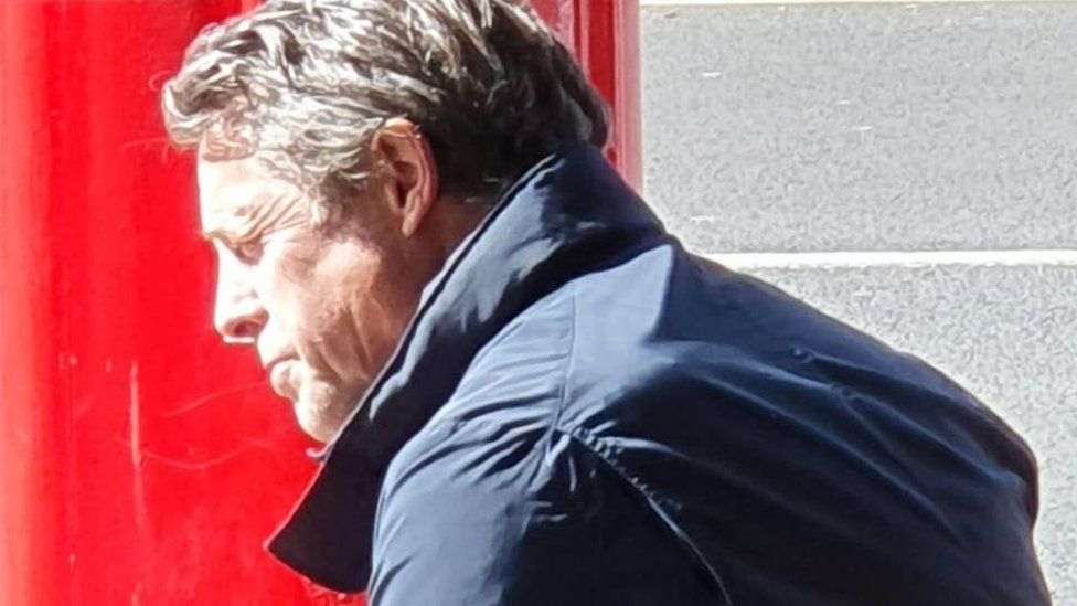 Hugh Grant outside bakery