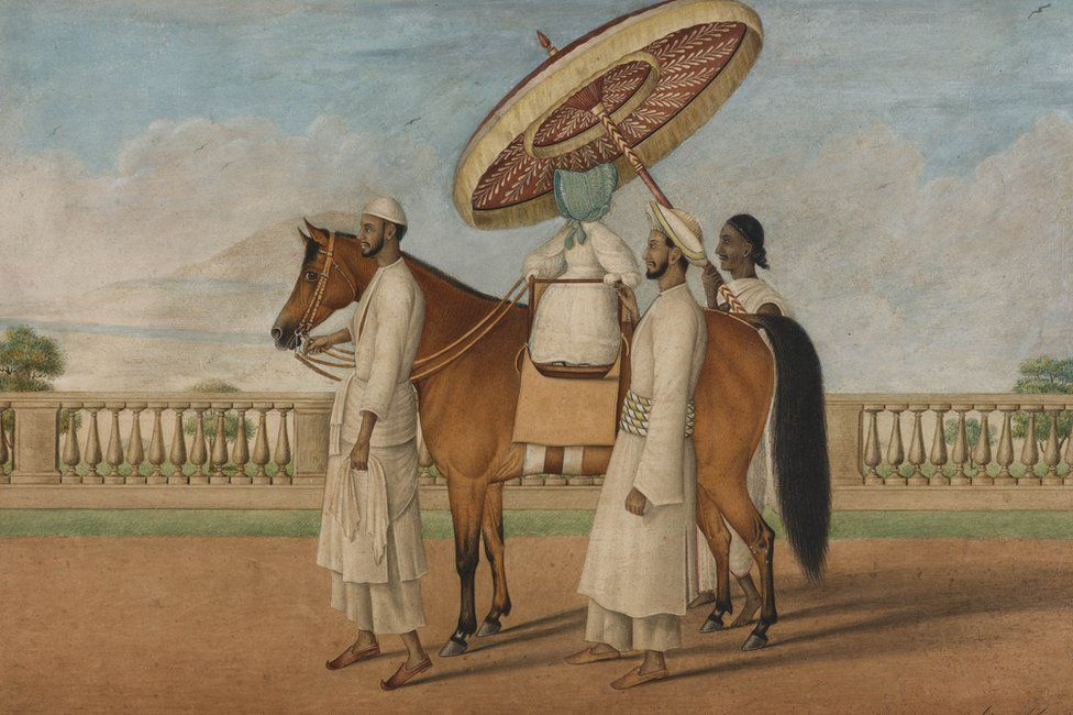 English child seated on a pony and surrounded by three Indian servants, 1830-1850