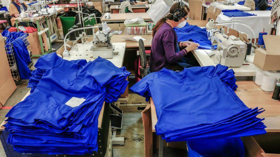 Woman sews scrubs