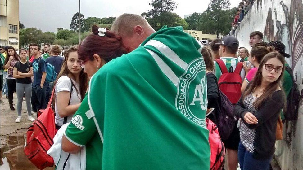 A handout picture made available by Diario do Iguacu shows supporters of the Chapcoense FC gathering at the club in Chapeco, Brazil, on 29 November 2016.